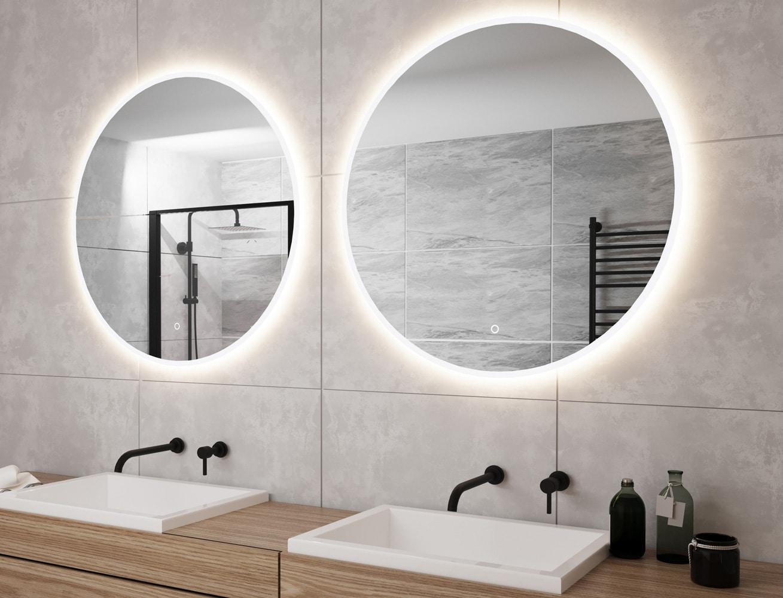 Heeft u 2 waskommen? Denk dan eens aan 2 ronde spiegels naast elkaar!