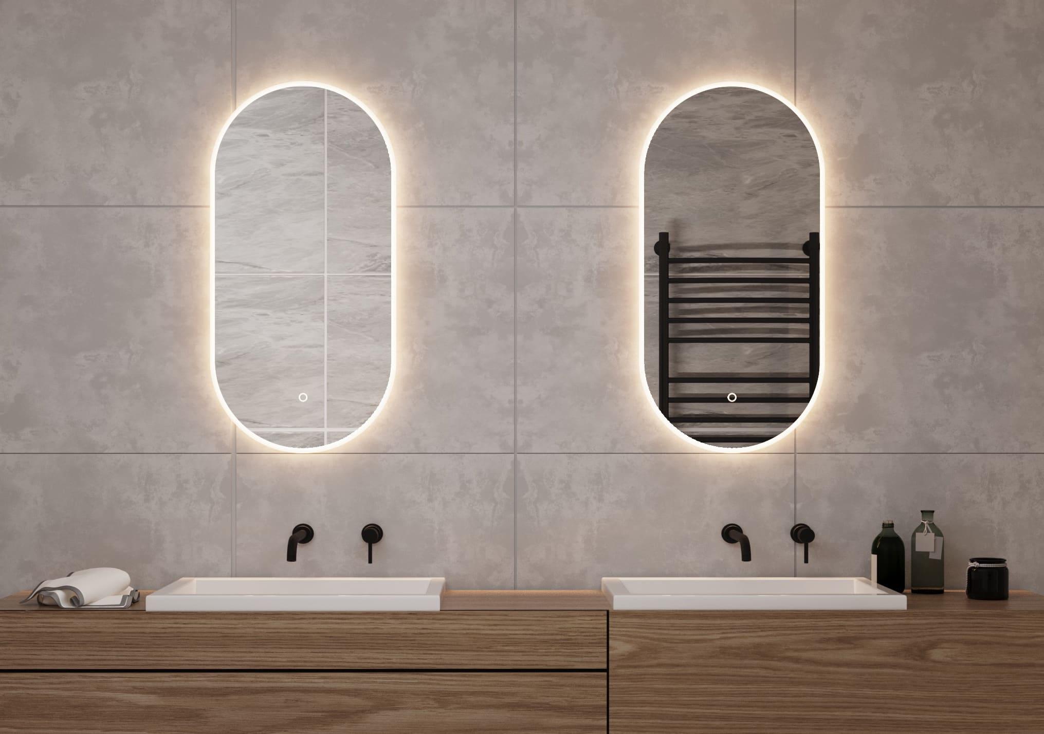 2 ovalen spiegels met led verlichting op grijze wand