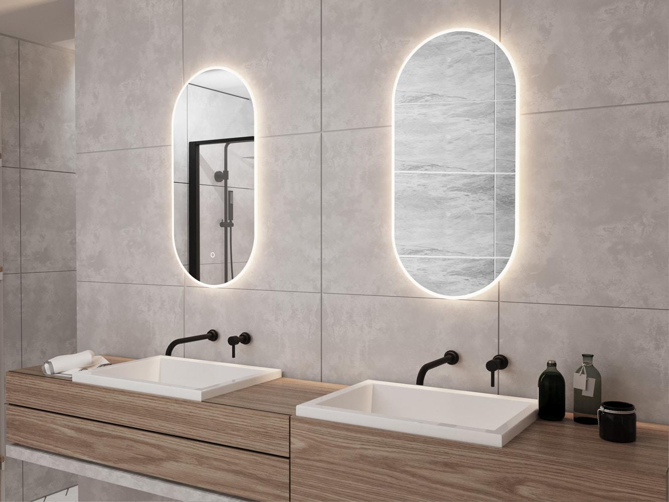 2 Ovale spiegels met led verlichting op grijze tegel
